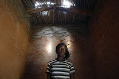 Marliya, 14, poses in her bedroom in the remote village of Hawkantaki, Niger, July 20. Marliya's family was paid just 50,000 francs ($100) for her dowry. Her father used up the money long before her wedding, and she was sent to her husband's home with only a tarp to sleep on.