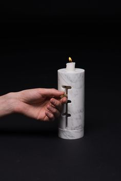 A marble candle holder that adjusts by Yaroslave Misonzhnikov.