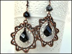 Black spinel and copper wire wrapped earrings by amorfia on Etsy, $50.00