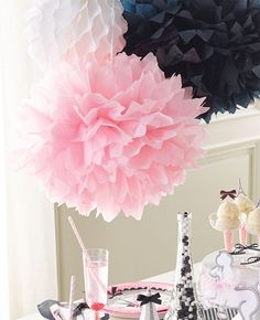 Pom poms are super chic and the perfect addition to your Paris party decorations! An easy way to add a little sophistication to a Parisian party theme for a birthday or hen do.