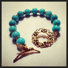 Spring 2013 Collection Teal Hummingbird bracelet made from teal stone beads, anyiqued gold spacers and an antiqued gold hummingbird toggle clasp. $26.99