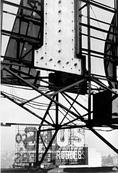 Walker Evans: Signs, New York City, 1928-29  The electric signs in the photograph alternately flashed the company's name and the names of its two principal products.