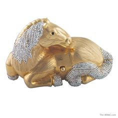 Judith Leiber New Scales | Judith Leiber minaudiere in the shape of a recumbant horse, the mane ...