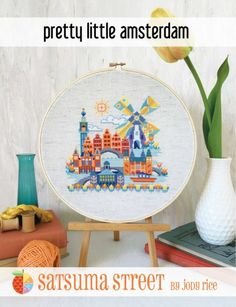 Pretty Little Amsterdam is the title of this cross stitch pattern from Satsuma Street that is stitched with DMC threads.