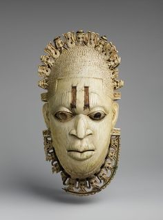 """Queen Mother Pendant Mask: Iyoba Benin Empire, century The Metropolitan Museum of Art """"This ivory pendant mask is one of a pair of nearly identical works; its counterpart is in the British Museum in London. Although images of women are rare in. Afrique Art, Art Tribal, African Sculptures, Art Premier, Queen Mother, Masks Art, African Masks, 3d Prints, Ivoire"""