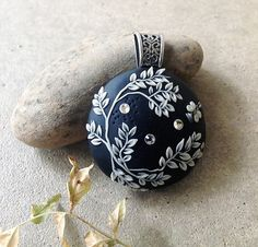 Black and White floral hand appliquéd polymer clay pendant