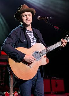 June 25: Niall performing at the 987 AMP Live in Detroit