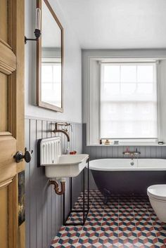 East London's most beautiful flat - A rolltop tub from the Cast Iron Bath Co sits on custom-coloured encaustic tiles, and the walls are painted in a gentle grey - House Bathroom, Interior, Vintage Bathroom, Home Remodeling, Shower Room, Cheap Home Decor, House Interior, Bathroom Interior, Bathrooms Remodel