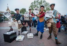 Newspaper boys hold the special commemorative newspaper at Disneyland on Disneyland's 60th birthday celebration Friday morning. http://www.ocregister.com/articles/disney-672399-disneyland-park.html