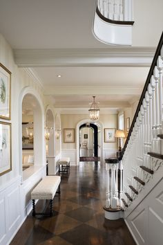gorgeous entry... the diamond cut flooring, the light & dark contrast with gold accents and all the arches make it bright and open!