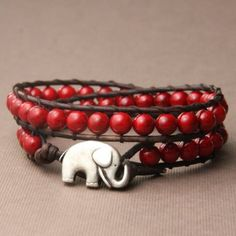 MORE THAN JUST A WRAP BRACELET!!!.... An elephant with it's trunk raised up is considered to bring good luck and an excellent fortune and to have the magical power to take away troubles. Brown leather with red stone beads and antique silver elephant button. To make a purchase please go to my online store www.theluckyelephant.etsy.com.
