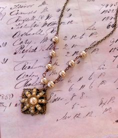 Adrienne... vintage assemblage,antique white pearl,wire wrapped necklace. Tiedupmemories