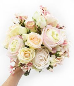 A large bridal posy of cream/pink garden roses, champagne + blush Paris roses and cherry blossom.