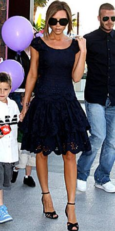 Look of the Day › April 20, 2008 Beckham took a birthday stroll with her family after leaving the Pink Taco restaurant in L.A. The 34-year-old star wore an eyelet dress with mile-high heels and oversized shades.