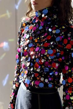 This sequin confetti blouse screams party time. Wear alone or under a blazer or a cover-up. Multiple options multiple ooohs and ahhhs!