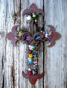 Large 12-Inch Rusty Fleur-de-Lis Wall Cross handcrafted by Oklahoma Artisan T.C. Cunningham, artist for Totally Crosses.