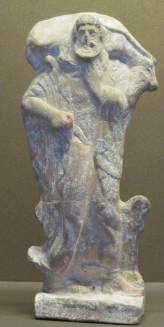 """Hermes Terracotta statuette, known as """"Hermes Criophore"""" - from ancient Thebes in Attica, circa 500-450 BCE - at the Louvre Museum"""