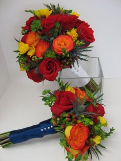 Bouquets of red and circus roses, yellow fressia, hypericum berries, blue thistle and bluplurm. Look at all those colors!  :-D