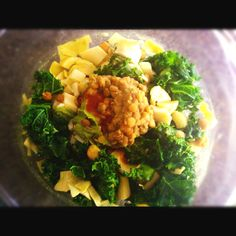 Slightly steamed Kale salad with artichokes, hearts of palm, homemade spinach hummus, and a dollop of curry lentils.