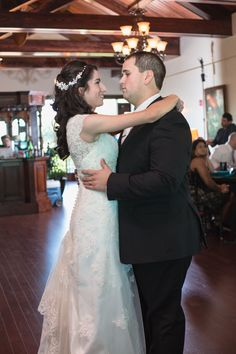 David's Bridal bride Linda in a lace cap sleeve gown for her lakeside wedding.