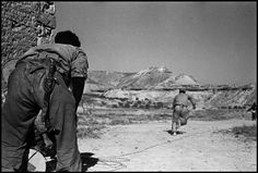 Robert Capa. Spain. A Republican machine-gunner behind stones, Nov7 1938                                                                                                                                                                                 More