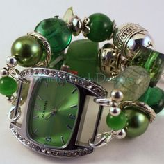 Beautifully green band & watch face featuring stone, glass, and acrylic beads, silver plated key charm and silver plated beads! Get it with our matching new necklace!