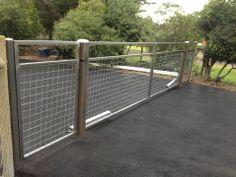 FLAT TOP STEEL DRIVEWAY GATES « Arbor Fence Inc | a Diamond Certified Company