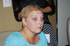 """Cancer patient Melanie McBee looks in the mirror after she practiced make-up tips during the """"Look Good, Feel Better"""" program.    """"Look Good, Feel Better"""" is an opportunity for cancer patients to receive tips on how to improve their physical appearance Tips on how to loose Weight Look better  Feel Better change habits more at HFDW"""
