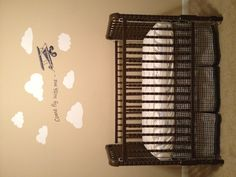 """Airplane nursery. Etsy cloud and """"Come fly with me"""" wall vinyls - perfect because Daddy's version of lullabies are old Sinatra tunes!  Pottery Barn crib bedding. My vintage Jenny Lind crib painted chocolate brown (don't worry, will switch it for a newer, safer crib when he starts moving around!)."""