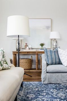 Fabulous Miramar rug from McGee & Co. in this young trad casual blue and white living room with white walls and neutral furnishings. Love the art. This is a fabulous online source for home furnishings.