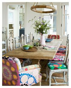 Loving the mismatched chairs! We can't get enough of these mismatched dining chairs with colorfully cohesive upholstery. LOVE THE MISMATCHED CHAIRS Mismatched Dining Chairs, Dining Room Chairs, Dining Area, Kitchen Chairs, Mismatched Furniture, Dining Tables, Small Dining, Trestle Table, Lounge Chairs