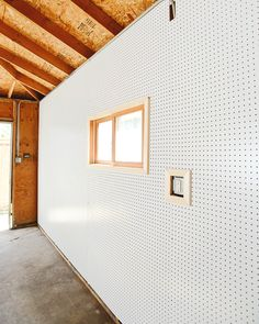 wall of pegboard in garage...perfect and easy way to finish the garage. No need for wall racks...just add peg hooks.