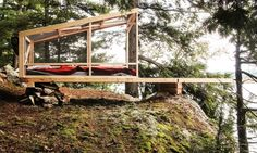 Studio North built the Dream/Dive Platform out of salvaged materials on the edge of Bobs Lake in Ontario.