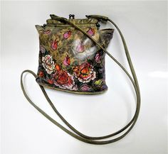 A personal favorite from my Etsy shop https://www.etsy.com/listing/496031544/vintage-hand-painted-cross-body-bag-or