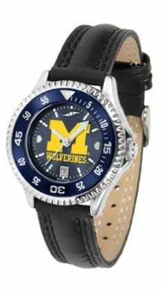 Michigan Wolverines Competitor Ladies AnoChrome Watch with Leather Band and Colored Bezel by SunTime. $85.45. Showcase the hottest design in watches today! A functional rotating bezel is color-coordinated to compliment the NCAA Michigan Wolverines logo. A durable, long-lasting combination nylon/leather strap, together with a date calendar, round out this best-selling timepiece.The AnoChrome dial option increases the visual impact of any watch with a stunning radia...