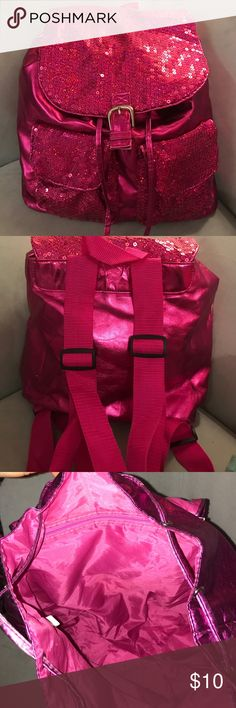 Pink sequin backpack Pink with sequins on the go backpack. Little starch above left pocket. Adjusting straps. Snap closure. For your special young lady. NO RETURNS Bags Backpacks