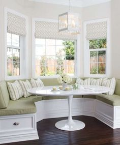 Amazing white dining nook is filled with a white tufted curved banquette, horseshoe shaped banquette, doubling as a window seat facing a round white dining table illuminated by an orb chandelier. Small Breakfast Nooks, Breakfast Nook Bench, Kitchen Breakfast Nooks, Breakfast Knook, Breakfast Room Ideas, Banquette Seating In Kitchen, Kitchen Benches, Dining Nook, Kitchen Booth Seating
