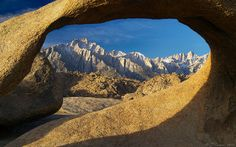 Mt. Whitney and Lone Pine Peak framed by Mobius Arch. Alabama Hills, California