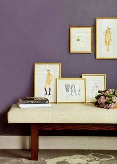Had been trying to configure an artful arrangement of all my favourite paintings, photographs, and artwork, that is, until I happened across the simplicity of this exclusive arrangement of fashion illustrations. The uniform gold frames against the deep lavender adds a beautifully luxe and elegant element to an otherwise perfectly simple grouping.{see also:}> purple reign> »