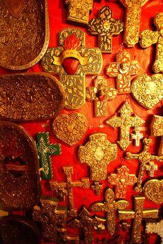 golden wall of milagro crosses