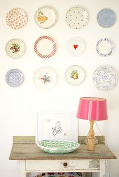 another row of plates by wood & wool stool, via Flickr
