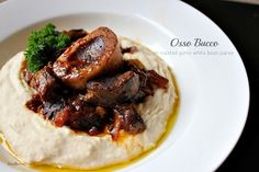 Osso buco, on roasted garlic white bean puree. Hearty, wholesome meal for cold weather. #Italianfood Pressure cooker recipes.