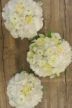 Bridal bouquet with roses, ranunculus, stock, lisianthus and hydrangea. Designed by Forget-Me-Not Flowers.