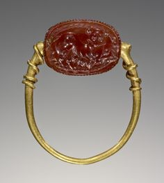 """gemma-antiqua: """"Etruscan carnelian scarab perhaps engraved with a chimera, dated to the century BCE. Found in the Getty Museum. Gold Rings Jewelry, Old Jewelry, Antique Jewelry, Jewelery, Vintage Jewelry, Viking Jewelry, Ancient Jewelry, Getty Museum, Garnet Earrings"""