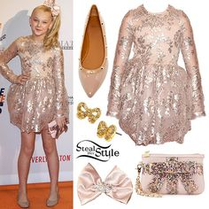 JoJo Siwa attended the Race To Erase MS Gala on Friday night wearing a dress from the Isabella Couture Blush Pink Collection (exact style not available), 14th & Union Kiana Flats ($49.97) in nude patent leather, the Betsey Johnson That's A Wrap Sequined Wristlet ($44.00), in blush pink with rainbow sequins, earrings similar to the Betsey Johnson Sugar Critters Gold Bow Studs ($9.99), and a custom hair bow made by her mom.