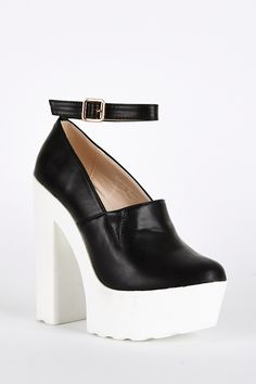Black Shoe with Cleated Sole and Ankle Strap Detai