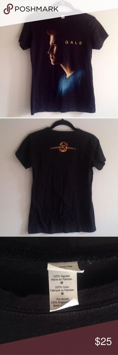 The Hunger Games Gale t-shirt size medium The Hunger Games black t-shirt with a picture of Gale (Liam hemsworth) on the front and the hunger games mocking jay symbol on the back. From hot topic. Size medium, pre-shrunk cotton tee. Bundle to save! #black t-shirt, black tee, Hot Topic tee, Hot Topic t-shirt, Hunger Games t-shirt, Gale t-shirt, mocking jay t-shirt, Liam Hemsworth t-shirt, Hunger Games tee, short sleeve t-shirt, short sleeve tee, Gale tee, Liam Hemsworth tee, pre shrunk cotton…