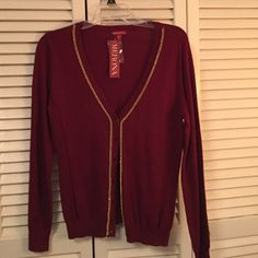 Merona Burgundy cardigan Merona brand Burgundy colored button up cardigan with gold chain trim. NWT. 53% cotton/40% rayon/7% nylon. Please ask for additional information if needed before purchasing. Merona Sweaters Cardigans