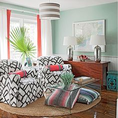 Sitting Room with slipcovered chairs, coral trimmed curtains