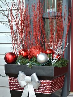 And don't forget to add some holiday magic to your front door. Turn an old plant pot and broken ornaments into a welcoming display